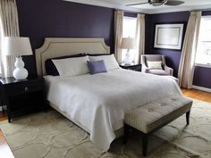 Purple blue and White Deco Bedroom: I love how they pair plethora of dark purple with warm neutrals and light for some contrast. The black furniture  really pops the white lamps and other items around it.