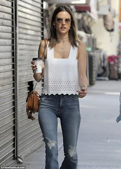 Work an eyelet tank top by A.L.C. into your wardrobe like Alessandra. Click 'Visit' to buy now. #DailyMail