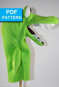 Alligator Hand Puppet with Move-able Mouth Pattern by TheTucsonPuppetLady.  Chomp! Chomp!  The only materials required to make this puppet are fleece, foam and felt.  With our detailed sewing instructions and video tutorials someone with basic sewing skills can create this alligator with attitude.  Pattern available only at https://www.etsy.com/shop/TheTucsonPuppetLady www.TheTucsonPuppetLady.com