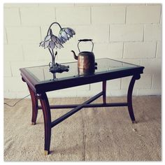 A stylish vintage Mahogany glass-top coffee/ occasional table with Brass feet caps in good condition in the Tables category was sold for on 20 Sep at by Lifespace Homeware in Gauteng Conditioner, Brass, Cap, Coffee, Stylish, Table, Vintage, Baseball Hat, Kaffee