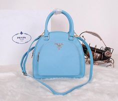 Real Purses Online Saffiano Leather Shoulder Bag SKyBlue - - Saffiano Calf Leather- double handle- Polished hardware- Detachable and Adjustable Shoulder Strap- Top Zip Closure- zip packet on front- Interior Prada Fabric liningSize: 25 x 24 x 10 cm = Calf Leather, Leather Shoulder Bag, Shoulder Strap, Shoulder Bags, Prada Outlet, Prada Saffiano, Prada Bag, Fashion Backpack, Calves