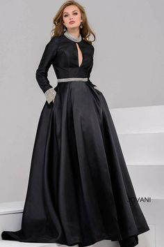 Gorgeous floor length pleated skirt ballgown with long sleeves and a key hole opening features crystal embellished high neck, waistline and cuffs.