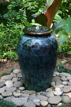 Exterior Ideas. Charming Backyard Water Fountains For House Exterior Design. blue metallic glazed pot with view of top for water fountain placed on natural grave