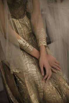 Wedding Trends: Statement Jewelry Gold lace cuffs by Elena Kougianou – This looks so pretty with, what appears to be, a gold wedding dress.