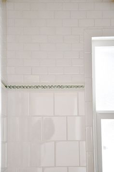 Squares + beaded pencil + penny rounds + small subways = subtle yet interesting bathroom tile!