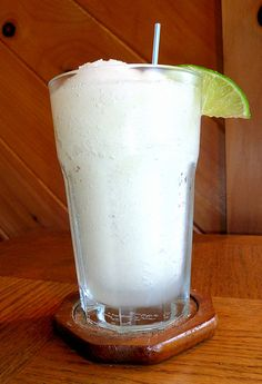 Frozen Coconut Limeade....Cream of coconut, minute maid limeade, ice; blend - drink up!! I'm sure even better with RUM