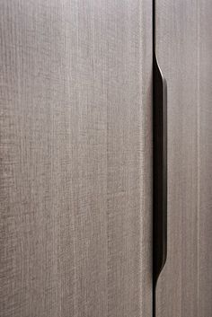 The wardrobe continues to evolve; Flou is happy to present a new version with a thermo-structured scratch-proof surface with a delightful textured finish. The elegance of the finish is… Wardrobe Door Handles, Wardrobe Doors, Closet Doors, Dressing Design, Joinery Details, Cupboard Storage, Storage Shelving, Furniture Handles, Wardrobe Design