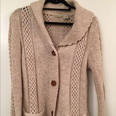 Beige sweater 4 large brown buttons dress up this cardigan. Cute scoop neck, hits a little below waist. Excellent condition. Rubbish Sweaters Cardigans