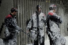 MESSY DEMONSTRATION: Members of the Catalan Regional Police were sprayed with foam Thursday in Barcelona by firefighters demonstrating against the government's spending cuts in social services. (Josep Lago/AFP/Getty Images)