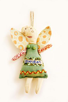guardian angel on wall small    Her wings are parts of a very old quilt.