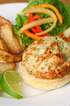 Ingredients:  2 cloves garlic, chopped ½-1 jalapeno pepper, seeded and chopped 2 chicken breasts (about 1 lb. total) 3-4 tbsp. cilantro Zest of ½ a lime 1 oz. tequila Dash of soy sauce Kosher salt and ground black pepper ½ cup panko bread crumbs  For serving: Burger