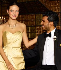Classic black and white tuxes look great with any #weddingcolor. #tuxedo #weddings #menswearhouse