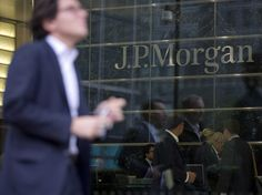 Ex-JPMorgan analyst cleared of insider trading charges (JPM)