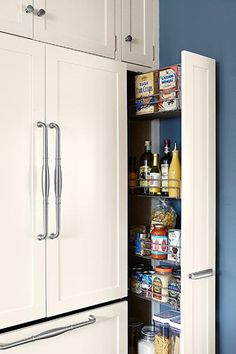 A paneled, counter-depth fridge gets its seamless built-in look from a flush pantry pullout on one side and deep cabinets on top. Kitchen Pantry Cabinets, Kitchen Storage, Kitchen Appliances, Deep Pantry Organization, Refrigerator Cabinet, Counter Depth Refrigerator, New Kitchen, Kitchen Ideas, Kitchen Decor