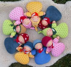 More sweet Waldorf dolls. Love the color combinations!