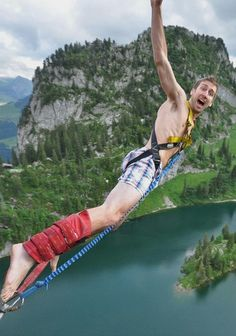 "Interlaken, Switzerland. At the Stockhorn Bungy site, you jump out of a gondola 134m (440ft) over the mountain lake of Stocksee. In case you were wondering: ""The reason he is in his boxers is because he swam in the lake before this photo was taken. Check out other amazing bungee jump places to add to your bucket list!"