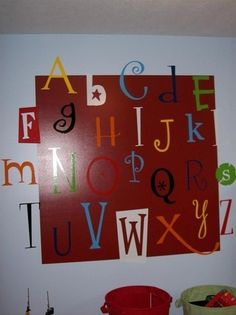 cricut letters I could do this...WAY cheaper and more simple than tracking down wooden letters!!!