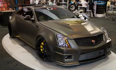 D3 Cadillac CTS V Coupe: With more tire than a Z06 Corvette, D3's version of a wide-body CTS-V coupe features a bigger supercharger, intercooler and KW coilovers. (Source: Road  Track)