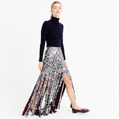 """Expertly embellished by artisans in Mumbai, this decadent skirt features traditional Shisha embroidery, or tiny mirrors that are hand-wrapped with fabric. Plus, they've added thousands of stacked sequins and glass beads that result in a glittering work of art. The fit is close through the hips and waist, then splits into dozens of individual flaps for a jaw-dropping entrance and unforgettable exit. <ul><li>Sits at waist.</li><li>35"""" long.</li><li>Falls to floor.</li><li>Poly.</li><li>Back…"""