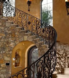 Curved stairs with intricate iron railings