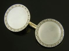 During the first half of the last century Carrington & Company was renowned for creating elegant cufflinks.  These wonderful cufflinks feature luminous mother-of-pearl centers surrounded by borders of stylized laurel leaves.  Crafted in 14kt white and yellow gold,  circa 1925.