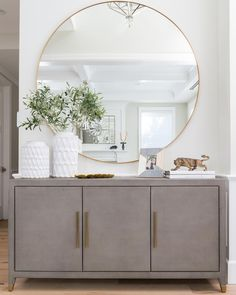 Home Interior 2019 A well-executed entry sets the tone for the rest of the house. Here, the goal was freshand sophisticated. by Bethany Nauert of Home Living Room, Living Room Designs, Living Room Decor, Bedroom Decor, Oversized Round Mirror, Round Mirrors, Large Mirrors, Home Entrance Decor, Entryway Decor