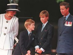 Princess Diana, Prince Harry, Prince William and Prince Charles watch the parade march past as part of the commemorations of VJ Day on Aug. 19, 1995, in London.