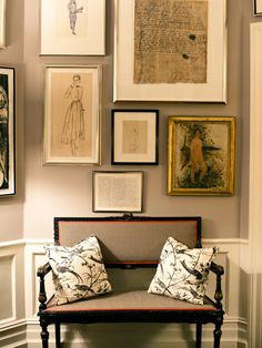 love this set up! art and antique settee.