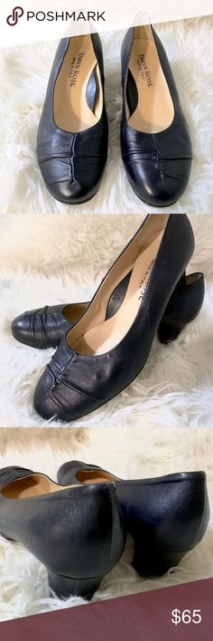 Taryn Rose authentic Italian leather pumps A lovely pair of Italian leather closed-toe pumps in a dark navy blue.  Ruched detailing on the toe.  These heels are in beautiful condition!  Heel: 2 inches Taryn Rose Shoes Heels