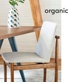Our Framework Dining Chair pairs solid wood and mid-century lines with the comfort of an upholstered seat and back.