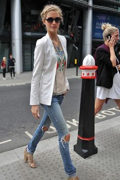 @DelevignePoppy offsets distressed denim with a luxe white blazer. Love. #LFW #StreetStyle