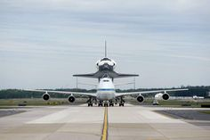 The space shuttle Discovery, riding atop a NASA 747 transport jet, arrives at Dulles International Airport in Virginia April 17, 2012