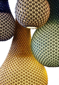 """Knitted"""" A series of light fixtures that combines technology with tradition; knitting wool threads in fixed patterns creates a three-dimensional sheet of fabric which serves as a lighting fixture. Collaboration between Oded Sapir and Ariel Zuckerman. The developing was done using the designer Adva Bruner."""