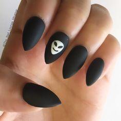 Matte black alien stiletto nails