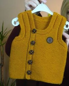 Knit Yellow Front Button Baby Boy Vest Model-Turkish Video of Knit Skewer Knit Yellow Baby Vest Model with an explanation in Turkish video. Nako color vega 10649 ball for this beautiful Front Button Baby Sweater .