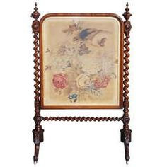 English Rosewood Needlepoint Fire Screen. Circa 1840