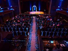 Wedding Ceremony & Reception @ The Castle Theatre 2.28.2015. Contact Wedding Coordinator Nicole (Events@castletheatre.com). We provided black rouge chair covers, serene blue sashes, and uplighting. #PalaceEvents #wedding #reception