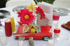 Car centerpiece with vintage candy and gerbera daisies