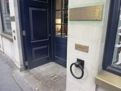 I wondered why there were two named iron rings outside Hackett in Bishopsgate, so I went in to ask. Turns out Charley and Browney are Jeremy Hackett's 'Ambassadogs'. See http://www.jeremyhackett.com/2010/09/charley-and-browney-brand-ambassadors.html
