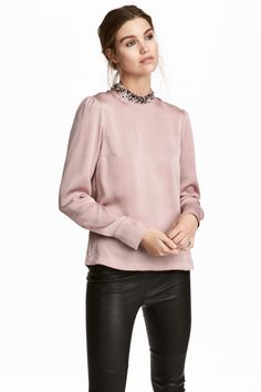 Powder pink. Straight-cut blouse in crêped satin. Small, sequined stand-up collar, opening at back of neck with button, and long puff sleeves with cuffs and
