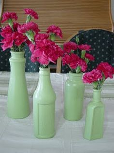 Old glass bottles for wedding centerpieces....or mason jars or tin cans all of which can be painted! and look very cute! Vintage garden or shabby chic