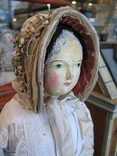 old papier maché doll  gentle face