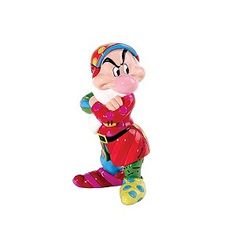 Disney Britto introduces Grumpy, its hard to take his grumpy face seriously with his colouful outfit. Romero Britto is a pop-artist and has created contemporary artwork using a palette of vibrant colours.