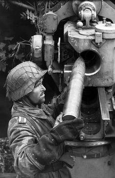 German soldier re loads an 88 MM