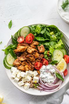 It's just like a chicken shawarma pita - but deconstructed! These Chicken Shawarma Bowls are made with a farro base, then topped with incredibly flavorful marinated chicken, shredded romaine, shaved red onion, cucumbers, cherry tomatoes, cubes of feta, fresh mint, and a super quick tzatziki sauce! #chickenshawarma #bowls #easymeal #tzatziki #healthy