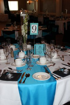 Blue, Black and White wedding reception tables.
