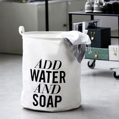 """Still has to be done and that was the text on the storage basket says it all . just """"ADD WATER AND SOAP."""" The laundry basket by House Doctor has two handles. Linen Storage, Laundry Storage, Laundry Hamper, Storage Baskets, Laundry Room, Folding Laundry, Clothes Storage, House Doctor, Furniture Styles"""