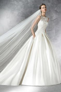 Simple princess dress with bateau neckline in mikado silk. Bodice with soutage and an overlay with bateau neckline. Pronovias 2016 wedding dress collection