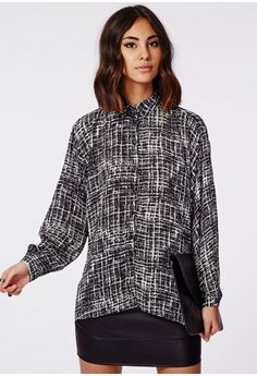 Style it out in monochrome grid patterns for a chic look this season. This over sized shirt features loose sleeves and a longer back for a flattering finish. Team yours with faux leather trousers and heels for a party finish.   Approx len...