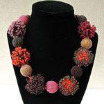 Zulu  Bead Necklace - Pom-poms: burgundy,coral,pink, gold.